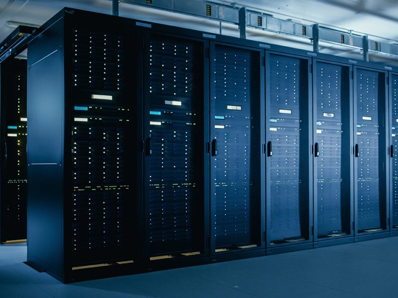 Shot of Data Center With Multiple Rows of Fully Operational Server Racks. Modern Telecommunications, Cloud Computing, Artificial Intelligence, Database, Super Computer Technology Concept.